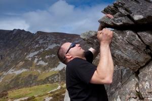Man climbing rock overhang
