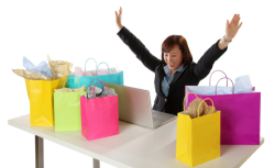 Woman shopping online surrounded by shopping bags