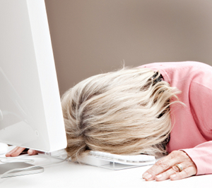 Tired Woman Asleep In Front of Her Keyboard