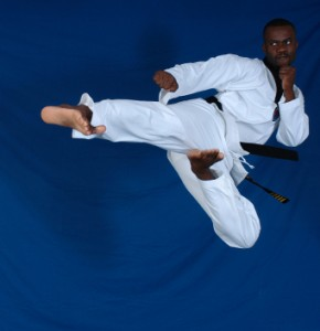 Image of martial artist doing a flying sidekick