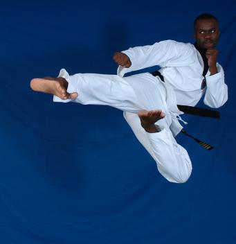 Image of martial artist doing a flying sidekick