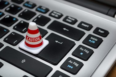 caution cone on computer
