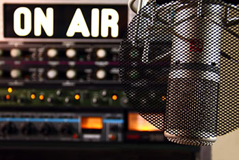on air sign with microphone